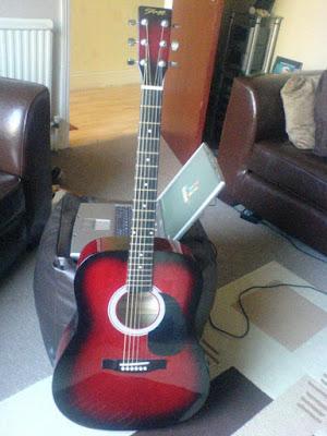 Bán Đàn Guitar Acoustic Stagg SW201RDS màu đỏ đen giá 1.5 triệu đồng
