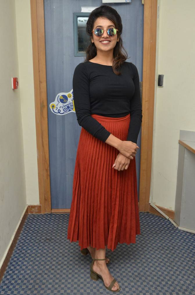 Actress Tejaswi Stills In Black Dress At Film Song Launch