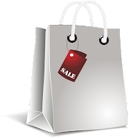 Picture of a white shopping bag with a sale sign on it.