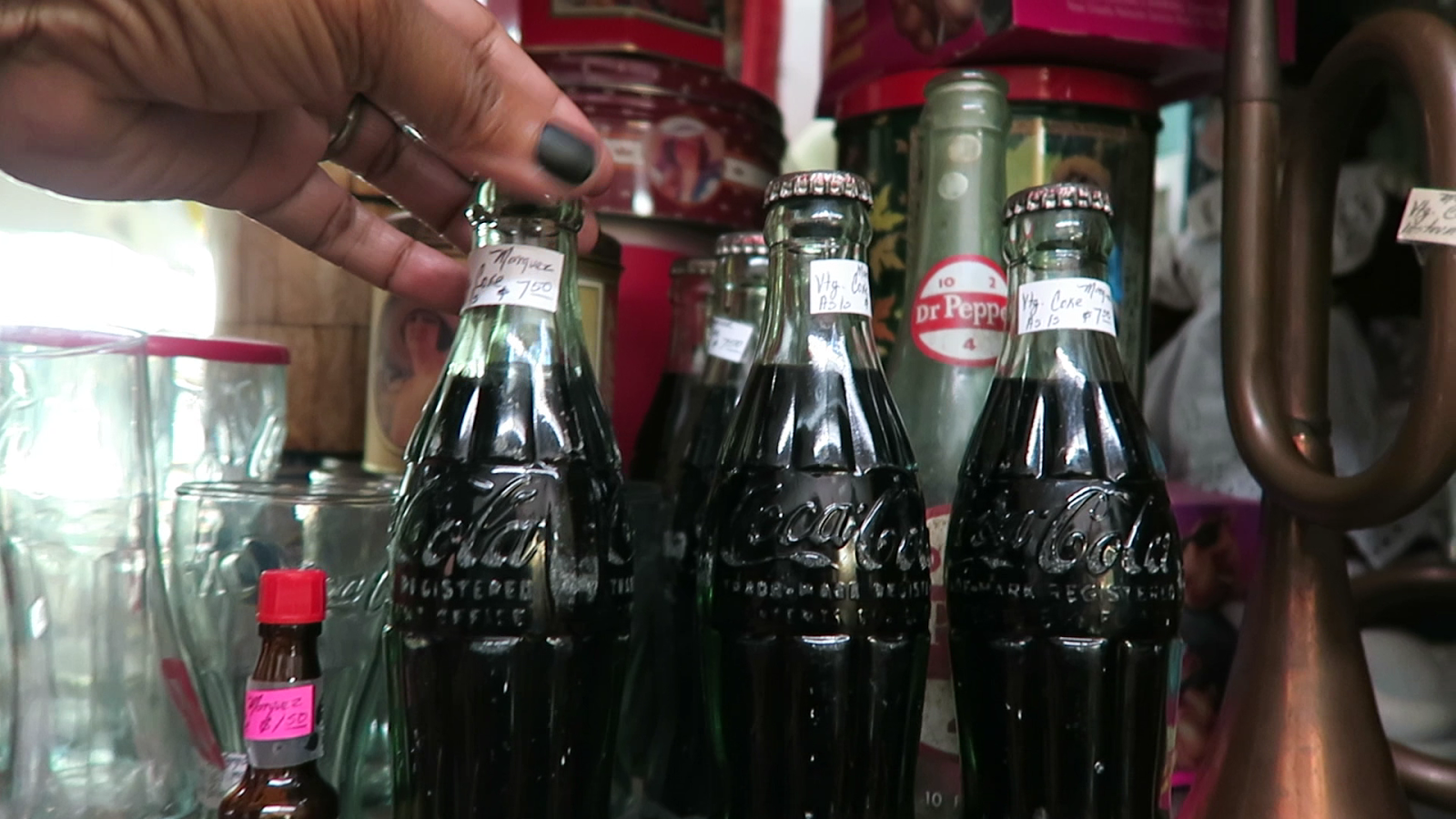 Image: Coke bottles at the thrift store. Taken by Tangie Bell and shared on Being Forty Something