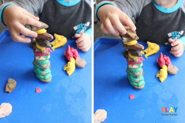 Buidling taller towers with rocks and playdough