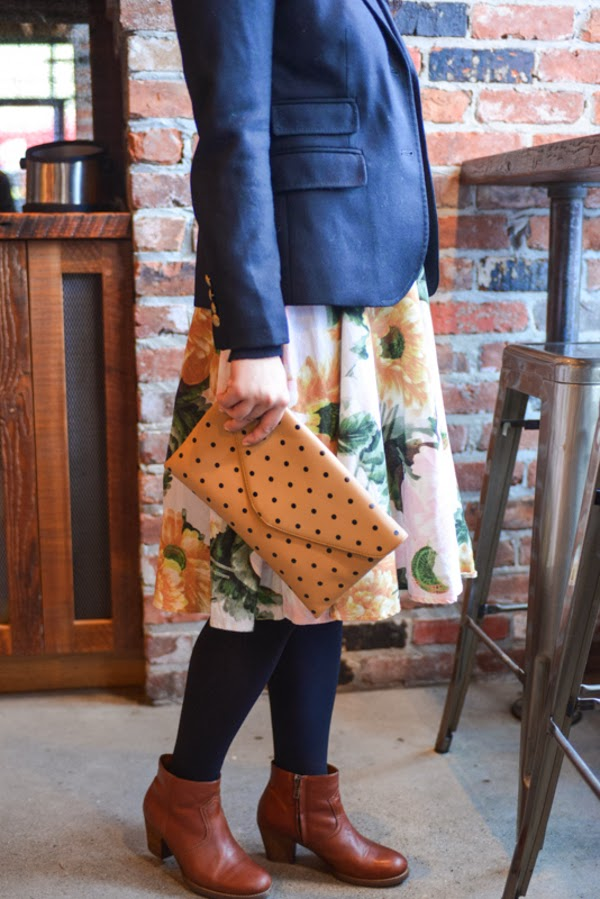 Black blazer, floral skirt, polka dot clutch, cognac leather boots