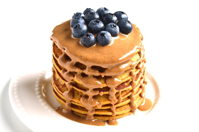 The perfect weekend breakfast has never been easier with these Pumpkin Spice Pancakes that are  made healthy with real pumpkin, Greek yogurt and pumpkin spice peanut butter! www.nutritionistreviews.com