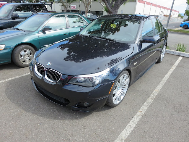BMW 550i after bumper, engine shield and support bracket replaced.