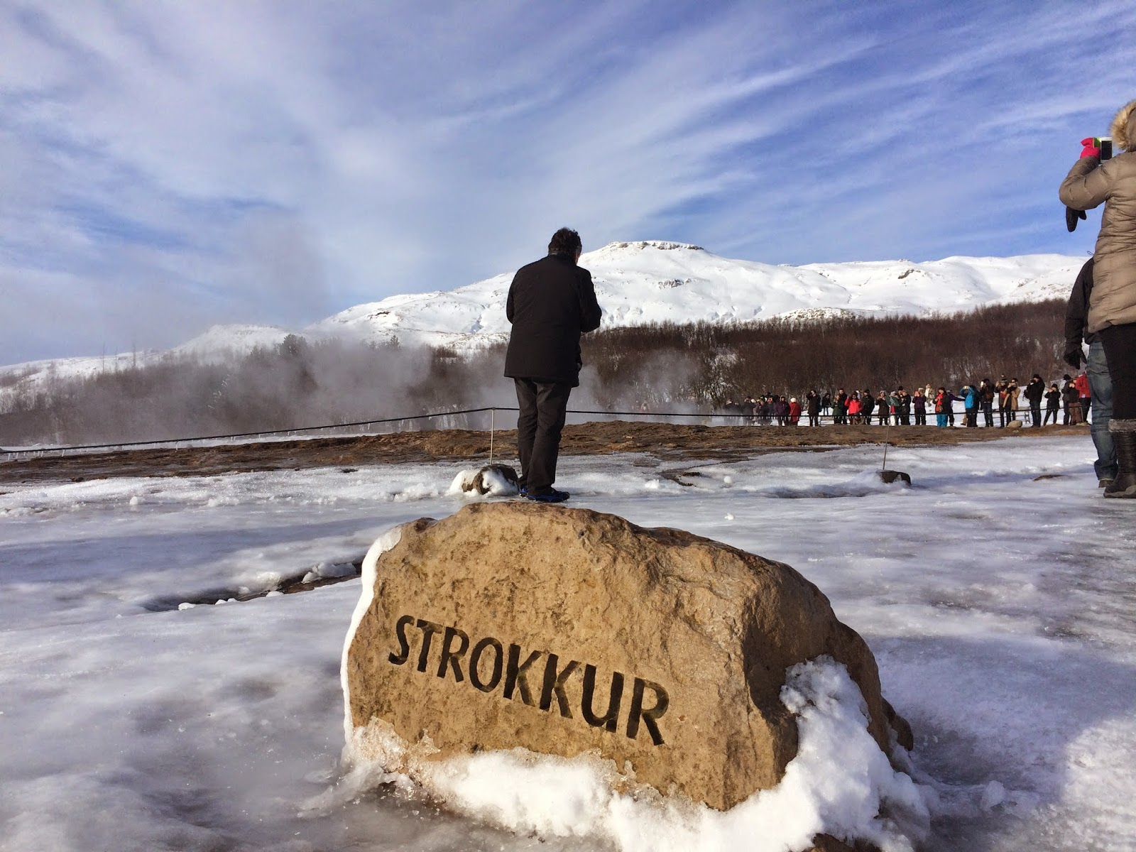 Crowds gather around the Strokkur geyser - Golden Circle Tour - Iceland