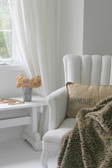Vintage chair, white painted farmhouse bench, and animal print throw - Hello Lovely Studio