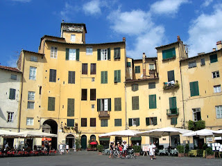 The Piazza dell'Antifeatro, on the site of a former  amphitheatre, is part of the charm of Lucca