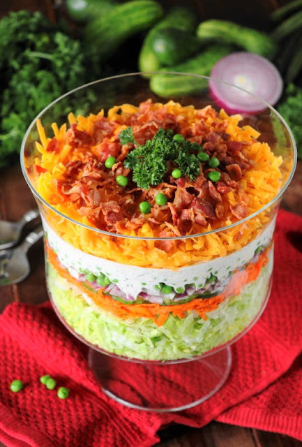 Layered Salad is beautiful prepared in a glass serving or trifle bowl.
