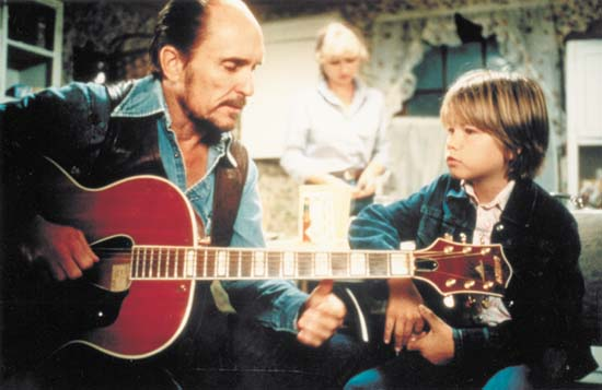 Mac teaching Sonny the guitar Tender Mercies 1983 movieloversreviews.filminspector.com
