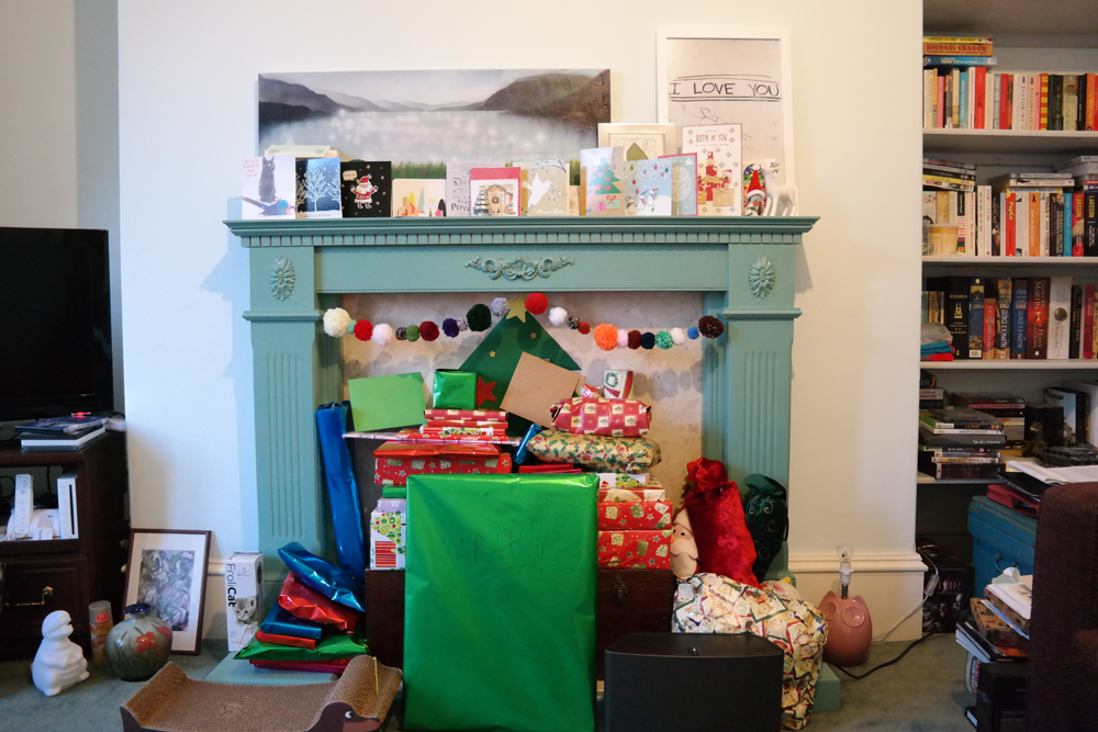 Fireplace filled with presents