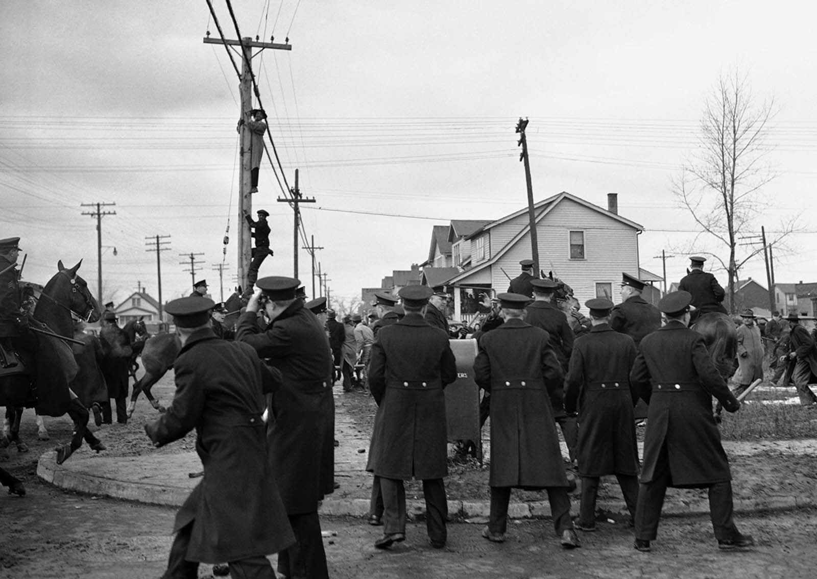 Stones flew despite a police riot squad's efforts to maintain order in Detroit, on February 28, 1942 between prospective Black tenants of a million-dollar defense housing project and white picketers who halted their moving vans. Several were hurt in the picket line skirmishes.