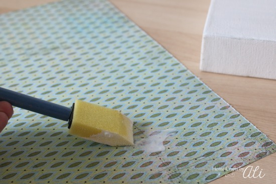 mod podge crafting glue on back of decorative scrapbook paper