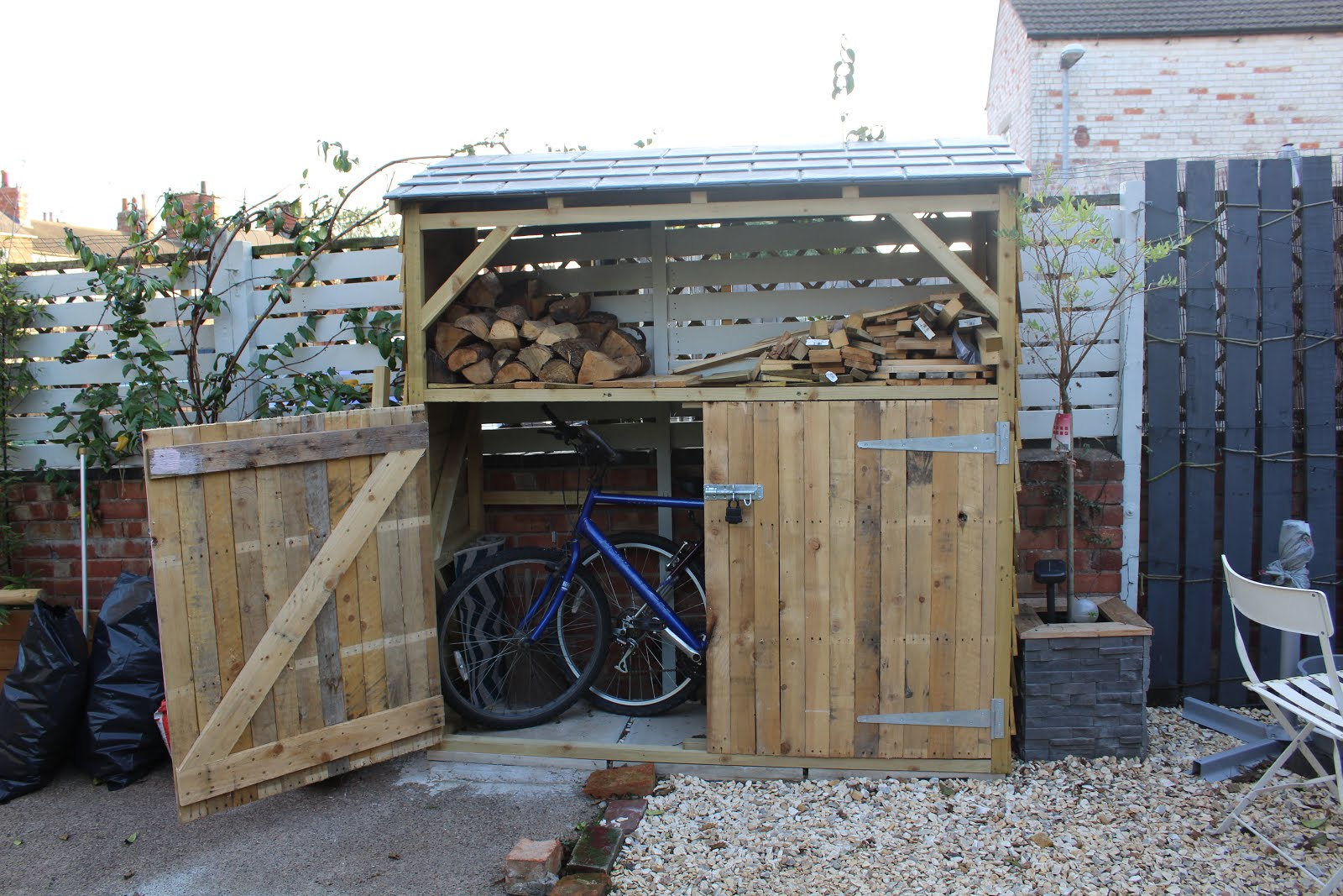 bike shed with log store