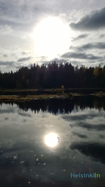 sun over the Black Lake at Nuuksio