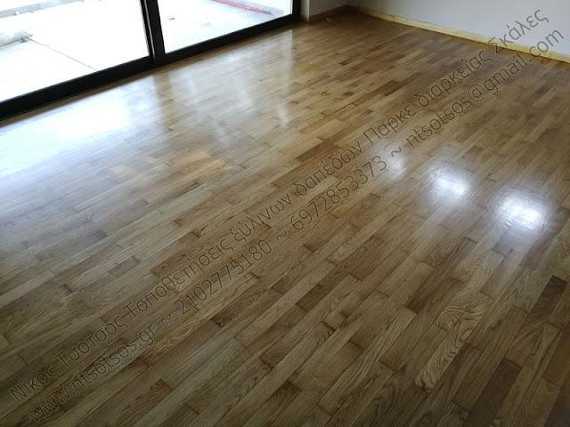 τρίψιμο και γυάλισμα σε ξύλινο πάτωμα