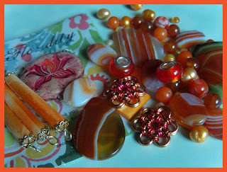 Polymer clay focal by Second Surf, panda beads, Mexican fire opal rondelles, pearls, carnelian, agate focals, Japanese 12-2 flowers in copper & orange, MOP resin beads, quartz, Mop diamonds, silk tube beads.