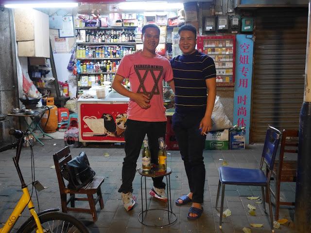 two mean drinking Harbin Beer in Guangzhou