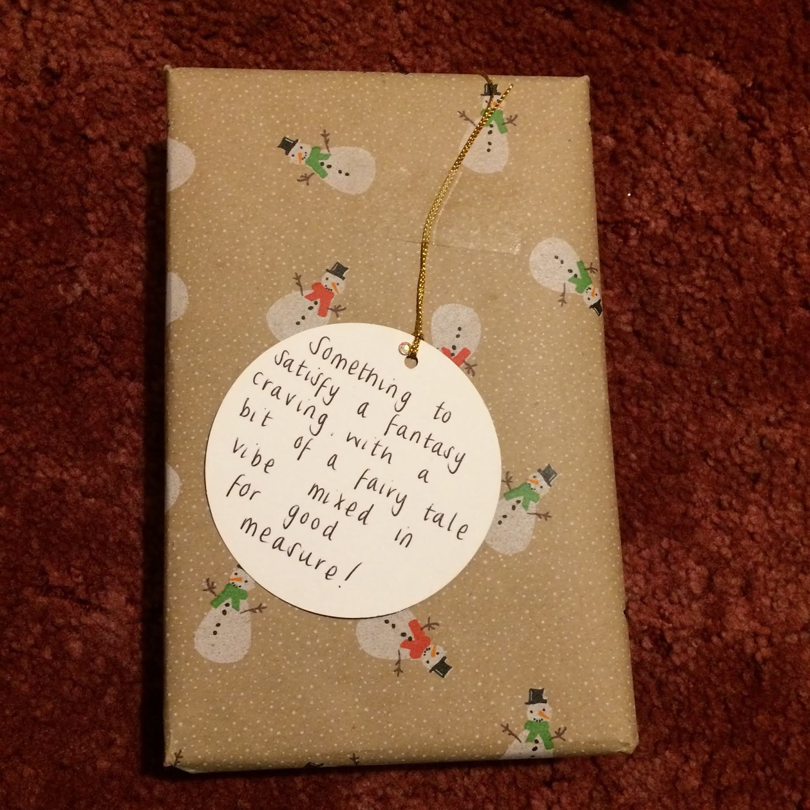 Wrapped present with a tag reading, Something to satisfy a fantasy craving with a bit of a fairy tale vibe mixed in for good measure!