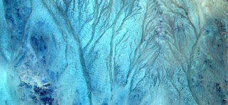 seabed in the desert,Abstract Naturalism,abstract photography deserts of Africa from the air,abstract surrealism,mirage in desert,fantasy forms and colors in the desert,abstract landscapes of deserts