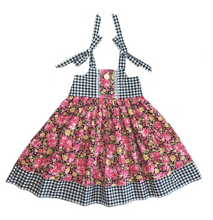 http://www.knot-dresses.com/dresses-and-tops/black-check-floral-ella-dress-for-girls/