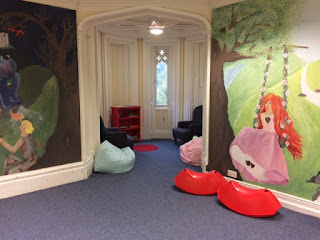 Play room with bean bags and rocking toys