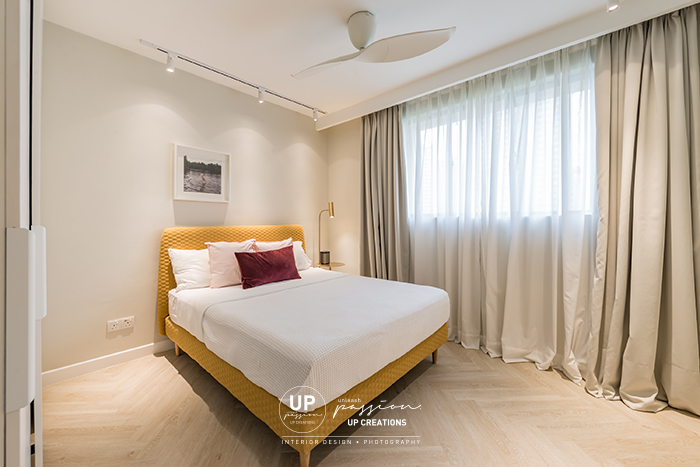 Mont Kiara Pines condo guest room with mustard yellow bedhead and divan with a beige color curtain and wall for a soft touch