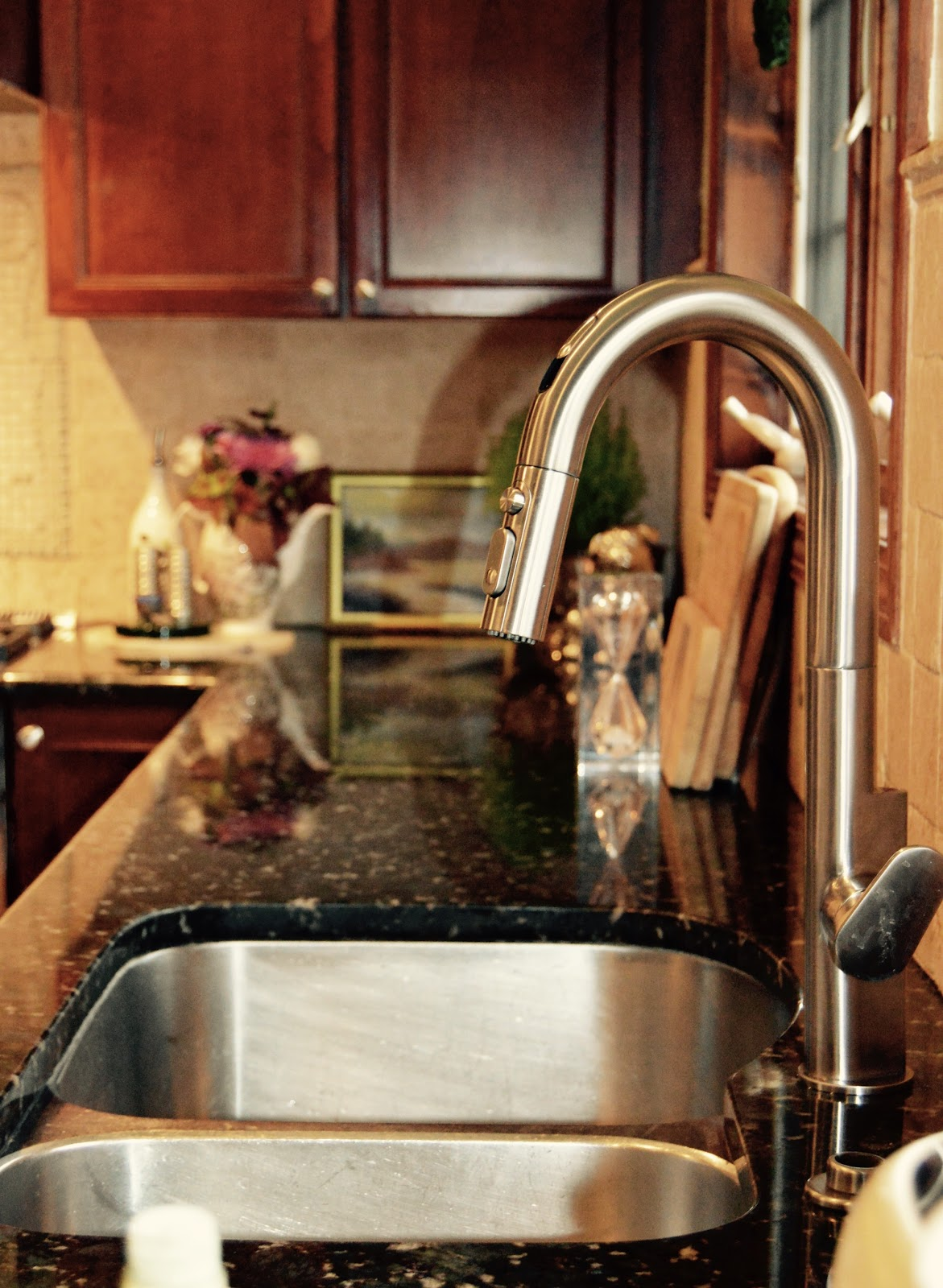 I installed the Beale Touchless / Pull Down Kitchen Faucet in stainless steel because I like the shine. It is a great improvement from the previous fixture ... & dvdInteriorDesign.com: Kitchen Refresh: 5 Ways To Update Your Kitchen