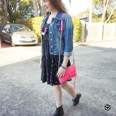 awayfromblue isntagram little black dress denim jacket and ankle boots for spring with pink bag