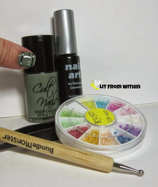 Bottle 'n stuff shot:  Cult Nails Grunge, black striper, the wheel of pearls, and the tweezers and dotting tool I used to apply them.