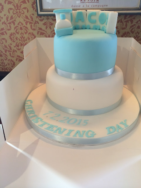 white and blue train christening cake