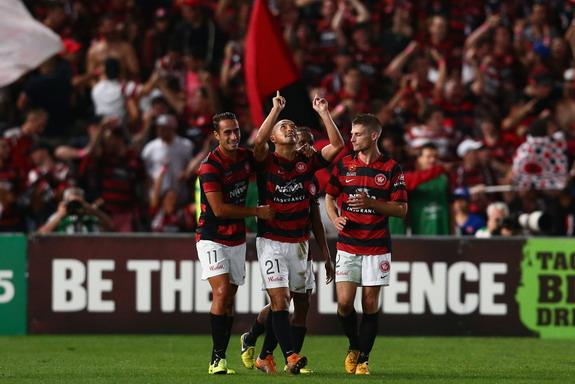 Shinji Ono celebrates with Western Sydney teammates after scoring against Brisbane Roar