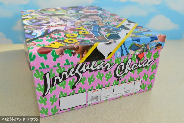front of shoe box with pink background and cactus print and shoe information boxes and Irregular Choice branding