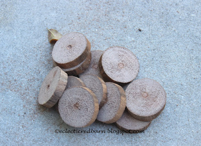 Eclectic Red Barn: Wooden disks cut from a large branch