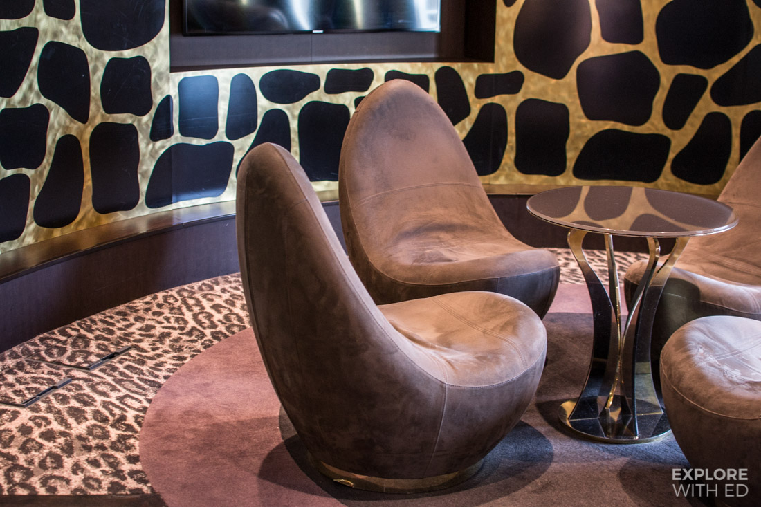 The Safari Lounge seating and animal print wallpaper and flooring