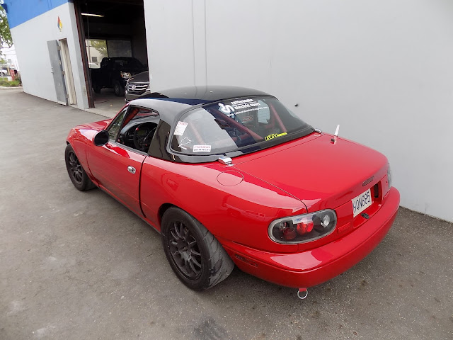 Spec Miata race car after auto body repairs and paint.