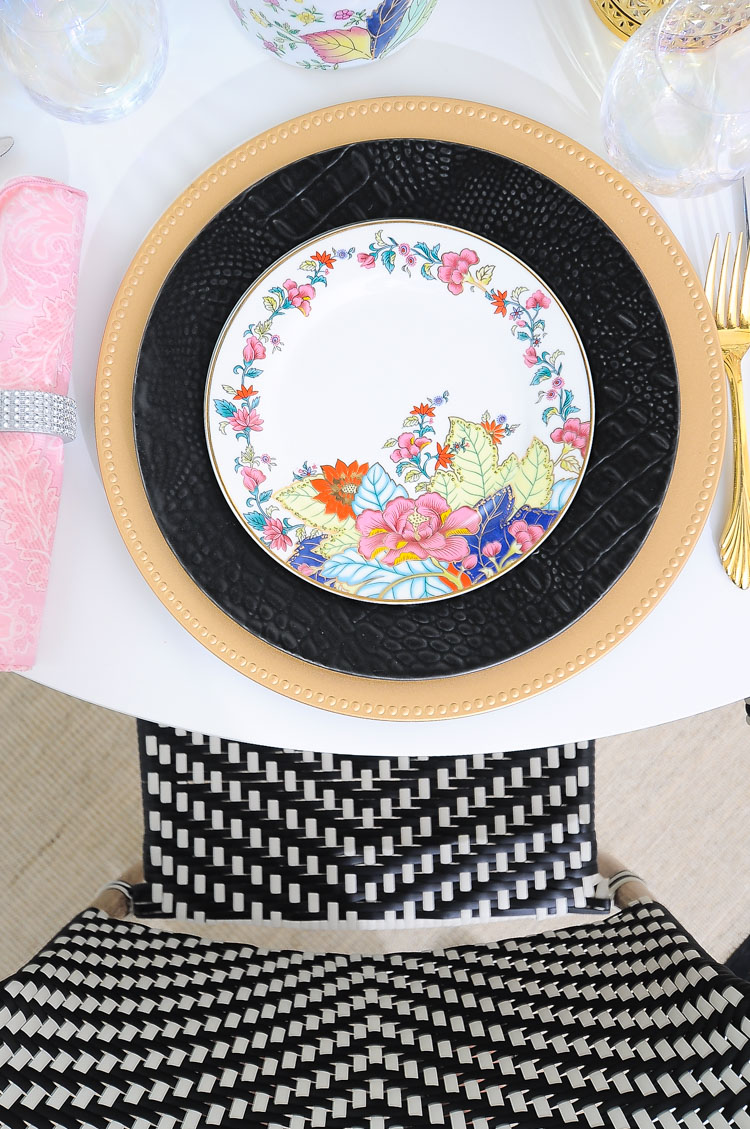Imperial leaf tobacco leaf china paired with a matte black plate and gold charger. Such a sleek and modern placesetting for a table.
