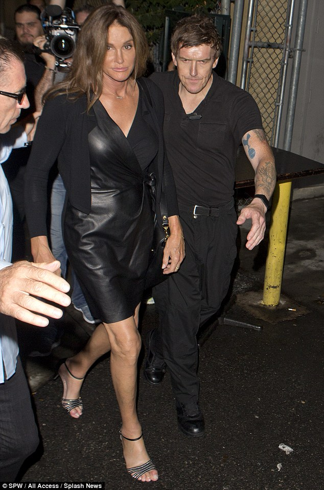 Caitlyn Jenner in a plunging leather dress at LA gay bar