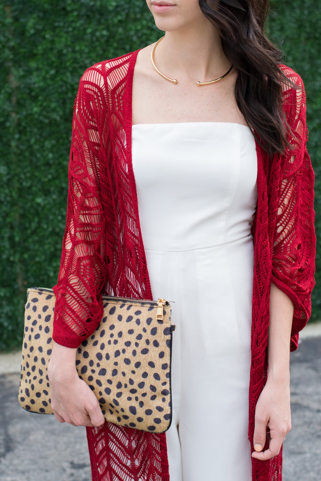 Boho chic style with minimal gold choker and leopard clutch