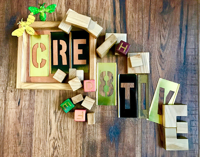 """Cre8tive"" spelled out in blocks and stencils"