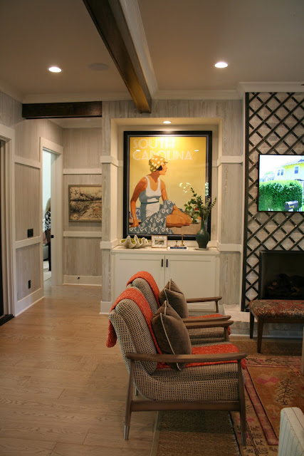 Custom South Carolina prints from mitchellblack.com and ironwork fireplace in cottage farmhouse Palmetto Bluff, SC | The Lowcountry Lady