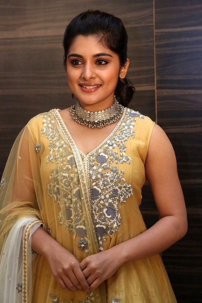Beautiful Telugu Girl Niveda Thomas Long Hair Photos In Yellow Dress