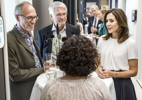 Crown Princess Mary of Denmark attended the opening of a new Grief Center. Princess wore Hugo Boss blouse, blue skirt