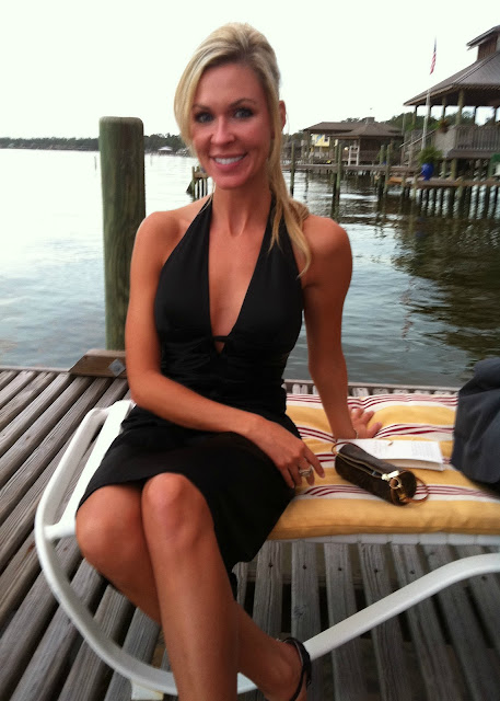 Model Designer Lauren Lorraine Jones in black dress on water