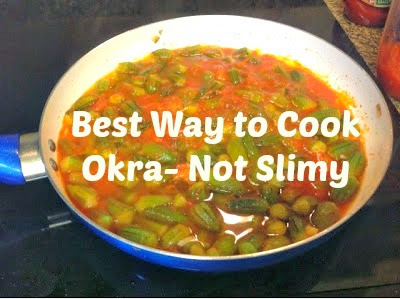 skillet with cooked okra and tomato sauce