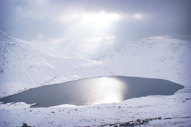 Grisedale Tarn in the snow, Helvellyn Walk, Lake District