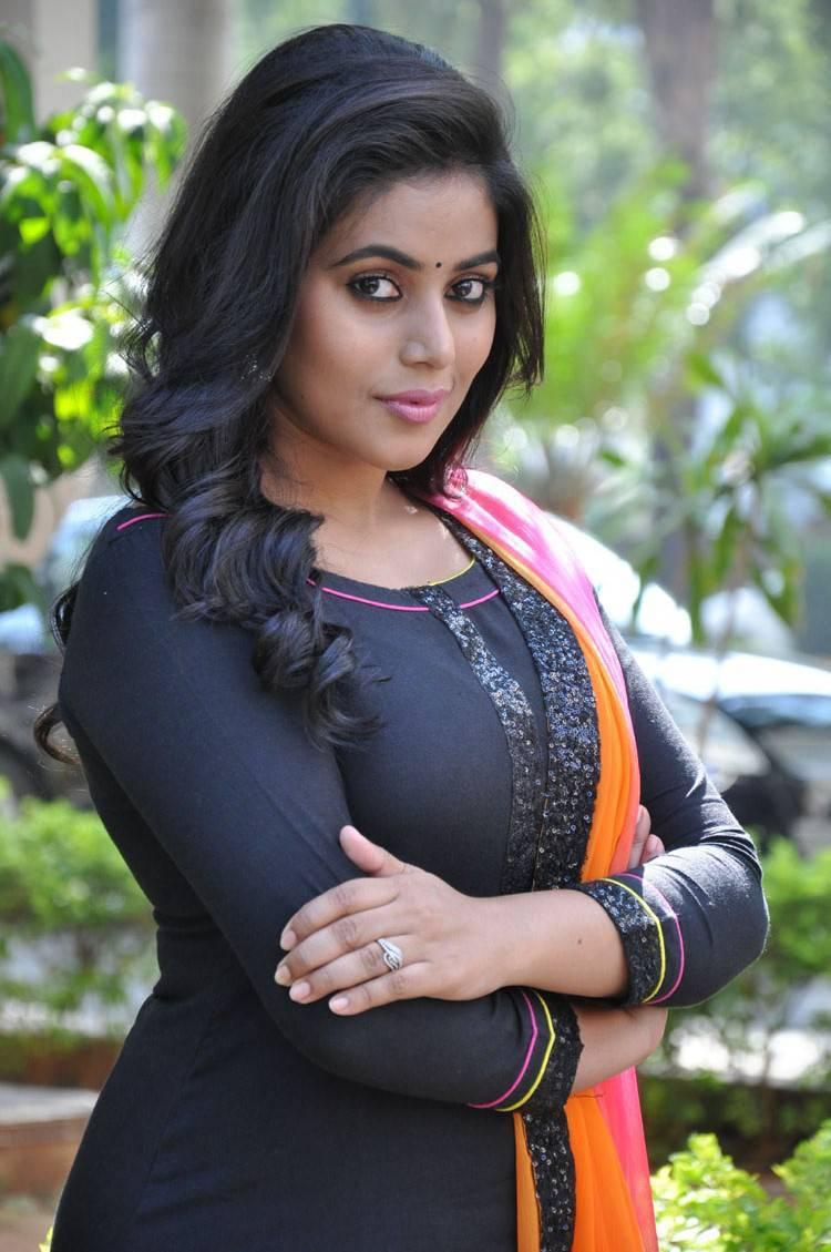 Poorna Long Hair In Black Dress At Film Press Meet