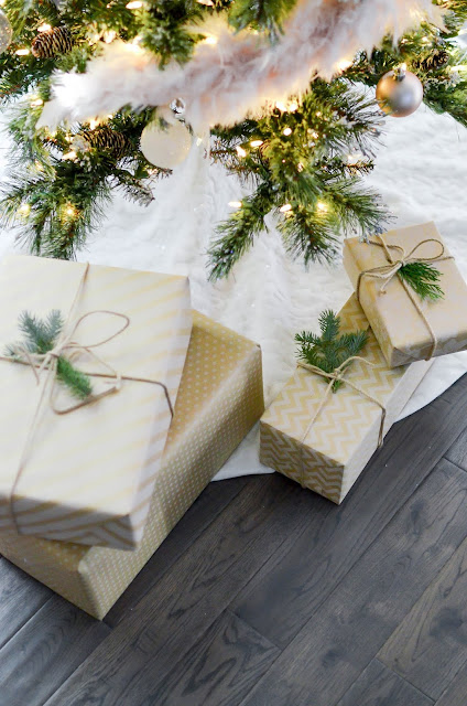 Christmas gifts wrapped and buy the tree