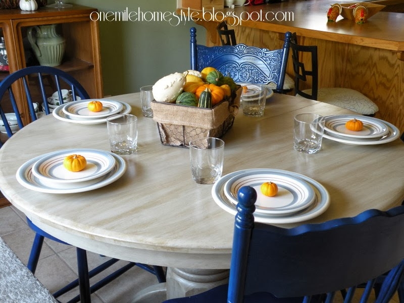 Navy blue dining chairs and cream table