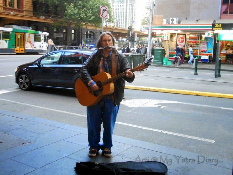 A musician hums a tune, on the streets of Melbourne