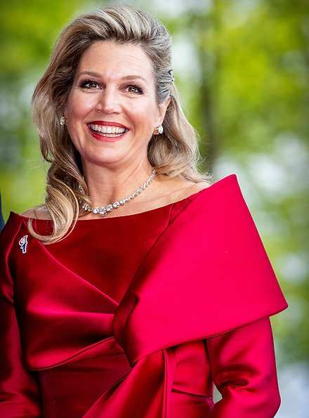 Queen Maxima wore a red top and red trousers. by Natan.Sarah's clutch bag. Carré Royal Theatre and around Amstel River